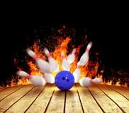 Bowling strike. Illustration of spread skittles in the fire and bowling ball on wooden floor Stock Images