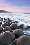 Bowling for Sunrise. Bowling Ball Beach on the California coast is home to dozens of 6ft in diameter, almost perfectly round boulders Stock Photo