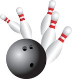 Bowling take down. Bowling ball knocking down all of the pins Royalty Free Stock Photos