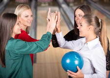 Bowling. Young group of female friends in bowling alley royalty free stock photo