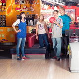 Bowling. Young people play the bowling Royalty Free Stock Photography