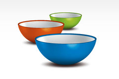 Bowls. Three colorful porcelain bowls arrange on white background Royalty Free Stock Photos