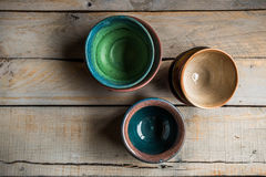 Bowls against a wooden background Royalty Free Stock Photos