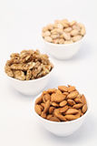 Bowls of almonds,wallnuts and pistachios Stock Photos