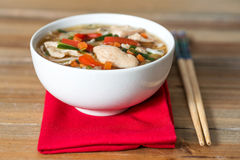 Bowls of Asian soup noodles and vegetables Stock Photo