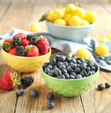 Bowls of berries and fruits stock photography