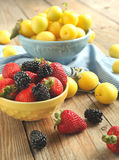 Bowls of berries and fruits stock image