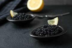 Bowls with black caviar royalty free stock photos
