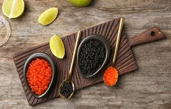 Bowls with black and red caviar. On table royalty free stock photos