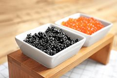 Bowls with black and red caviar stock photography