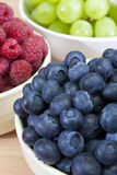 Bowls Blueberries Raspberries and Grapes stock photo