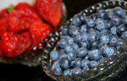 Bowls of blueberries and strawberries Royalty Free Stock Photo