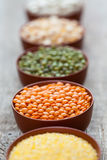 Bowls of cereal grains. Selective focus on red lentils. Royalty Free Stock Photography