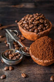Bowls with coffee beans and ground coffee on a wooden background Stock Photo