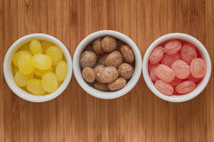Bowls of colorful candy drops Stock Images