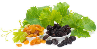 Bowls of colorful raisins with leaves of grape Stock Photography
