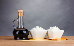 Bowls of cooked rice and soy sauce in jar Royalty Free Stock Photo