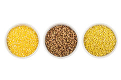 Bowls with corn grits, buckwheat, millet isolated on white Stock Image