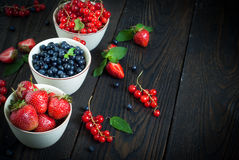 Bowls with different berries Royalty Free Stock Images