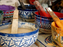 Bowls of different colored paints, Morocco Stock Photo