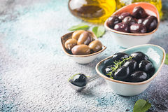 Bowls with different kind of olives Stock Photo