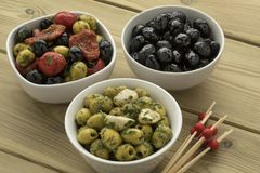 Bowls with different olives Stock Photos