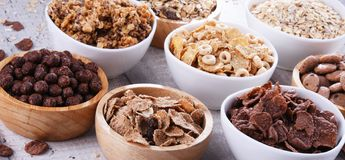 Bowls with different sorts of breakfast cereal products. Bowls containing different sorts of breakfast cereal products stock photo