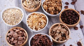 Bowls with different sorts of breakfast cereal products. Bowls containing different sorts of breakfast cereal products royalty free stock image