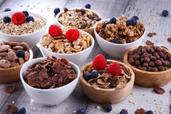 Bowls with different sorts of breakfast cereal products. Bowls containing different sorts of breakfast cereal products royalty free stock photo