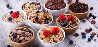 Bowls with different sorts of breakfast cereal products. Bowls containing different sorts of breakfast cereal products royalty free stock photography