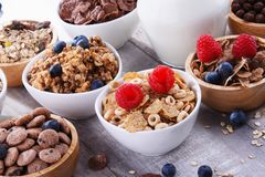 Bowls with different sorts of breakfast cereal products. Bowls containing different sorts of breakfast cereal products stock images