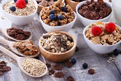 Bowls with different sorts of breakfast cereal products. Bowls containing different sorts of breakfast cereal products royalty free stock images