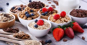 Bowls with different sorts of breakfast cereal products. Bowls containing different sorts of breakfast cereal products stock photos