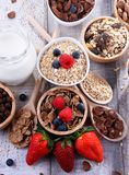 Bowls with different sorts of breakfast cereal products. Bowls containing different sorts of breakfast cereal products stock photography