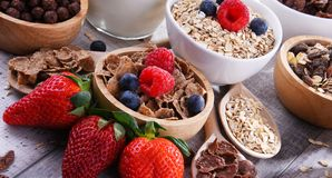 Bowls with different sorts of breakfast cereal products. Bowls containing different sorts of breakfast cereal products royalty free stock photos