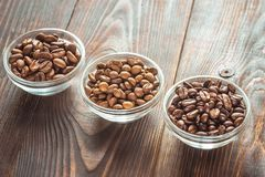 Bowls of different types of coffee beans royalty free stock photo