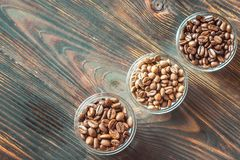 Bowls of different types of coffee beans stock image