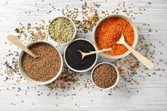 Bowls with different types of lentils royalty free stock image