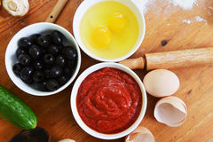 Bowls with eggs and olives Stock Image