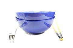Bowls with fork and chopsticks Royalty Free Stock Image