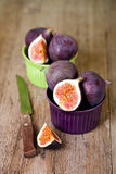 Bowls with fresh figs and old knife Stock Image