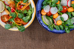 Bowls of fresh vegetable salad Stock Photo