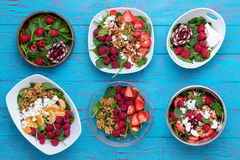 Bowls with fruit salads against blue background royalty free stock photos