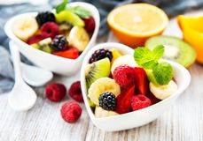Bowls with fruits salad. On a old wooden table stock photos
