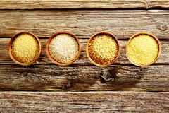 Bowls full of couscous, bulgur, millet and quinoa Royalty Free Stock Images
