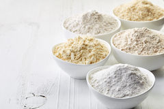 Bowls of gluten free flour stock images