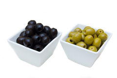 Bowls with green and black olives Royalty Free Stock Image