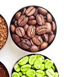 Bowls with green, roasted coffee beans, ground and Royalty Free Stock Photography