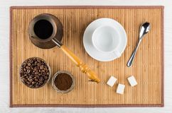 Ground coffee, coffee beans, turka, sugar, empty cup and spoon Stock Image