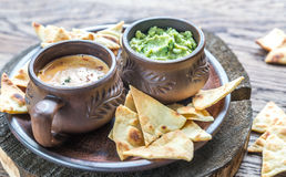 Bowls of guacamole and queso with tortilla chips Royalty Free Stock Image